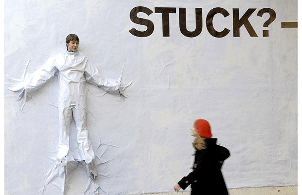 person stuck to a wall