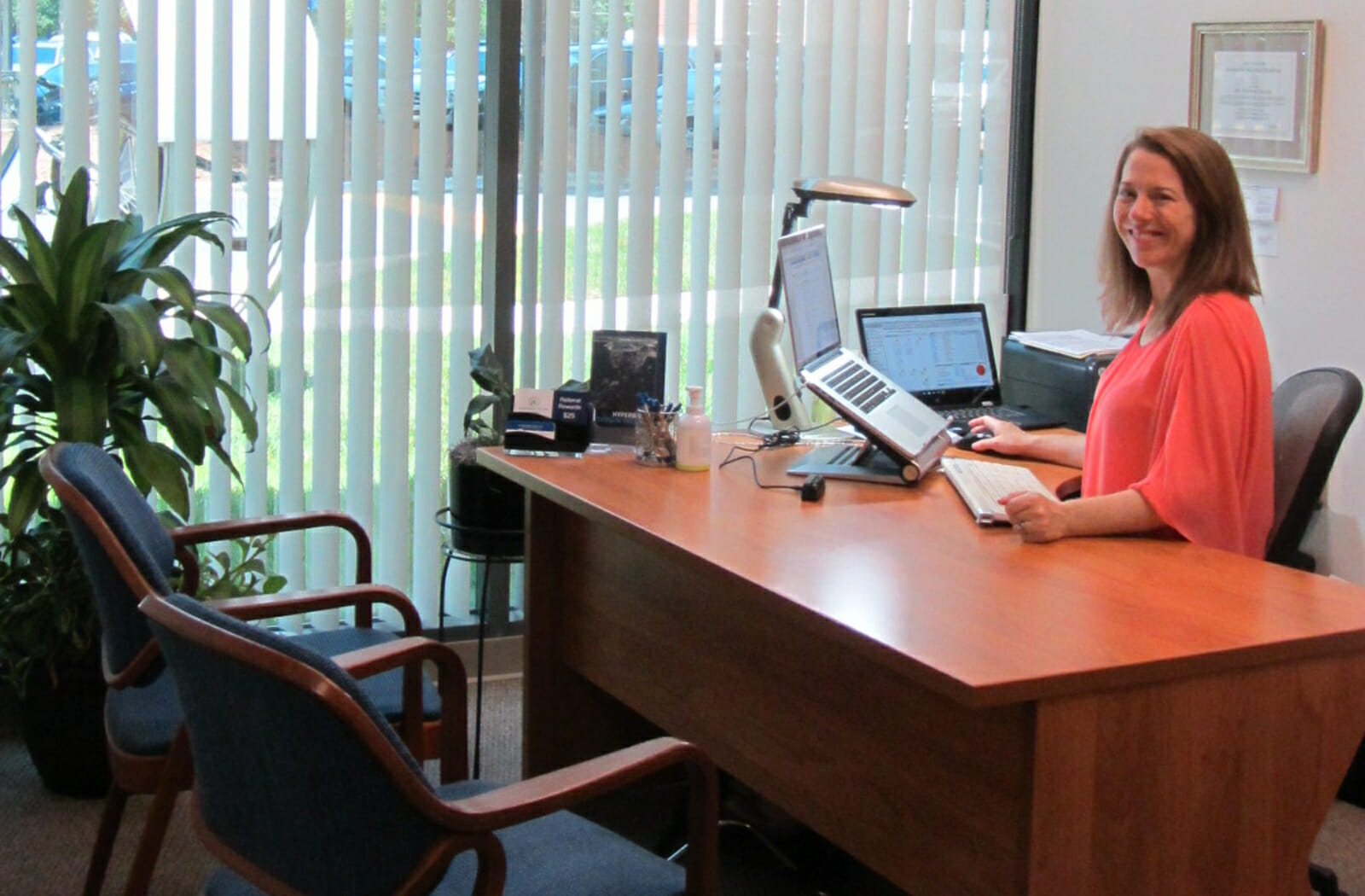 Dr. Melonni Dooley at her desk Welcomes New Patients for Naturopathic Medicine Therapies